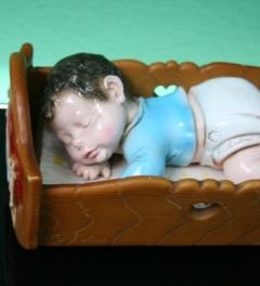 A. Luschesi/collection doll in a cradle***